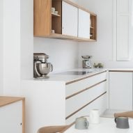 The kitchen combines white and oak
