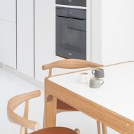 Furniture employs a similar oak and white palette