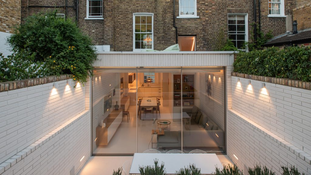 Moxon Architects remodels Victorian terrace with sunken garden and minimalist interiors