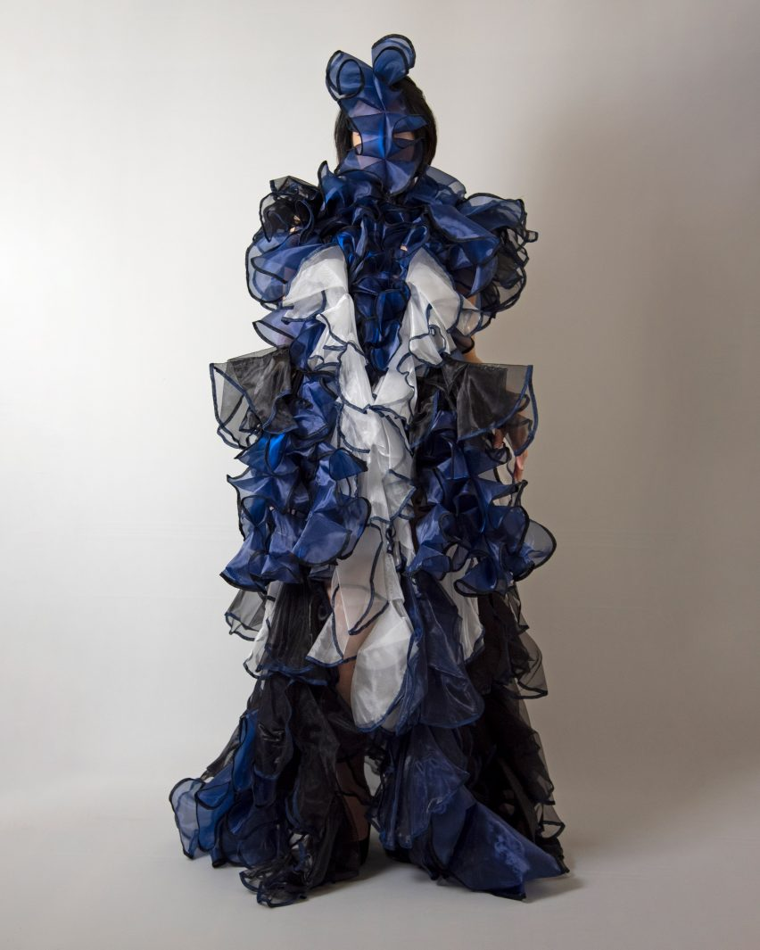 The garment is constructed using blue, white and black fabric by Ryunosuke Okazaki