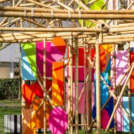 A bamboo pavilion decorated with coloured panels