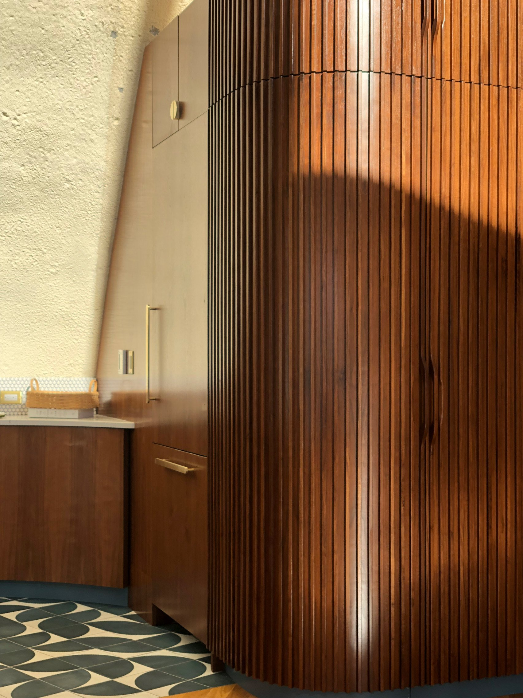 Fluted wood on custom cabinetry of Shell House