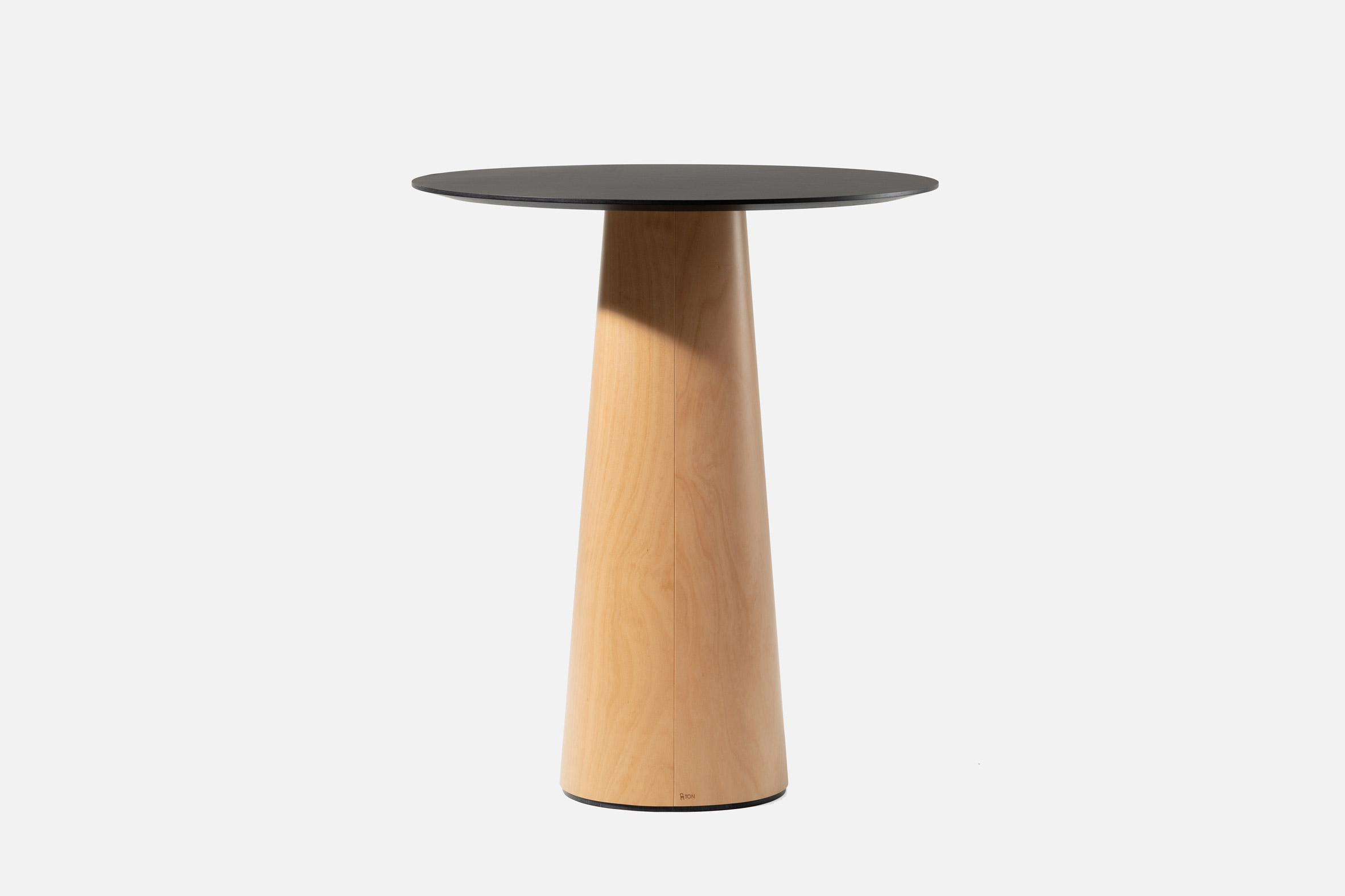 Small plywood table with a black top