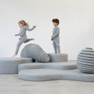 Kids playing on sculptures