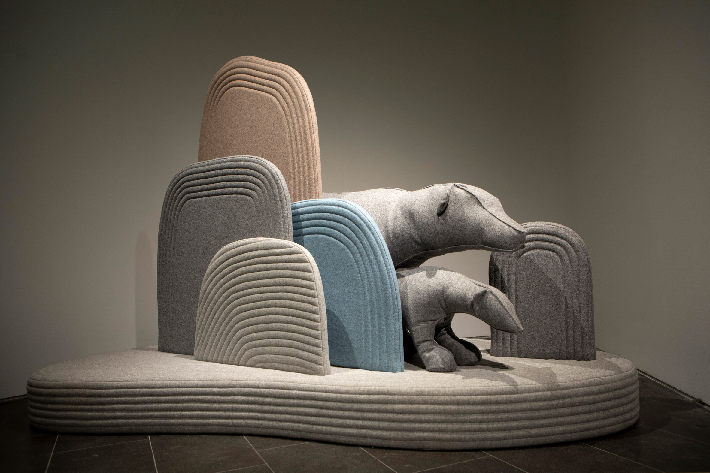Grey and blue-coloured wool sculptures