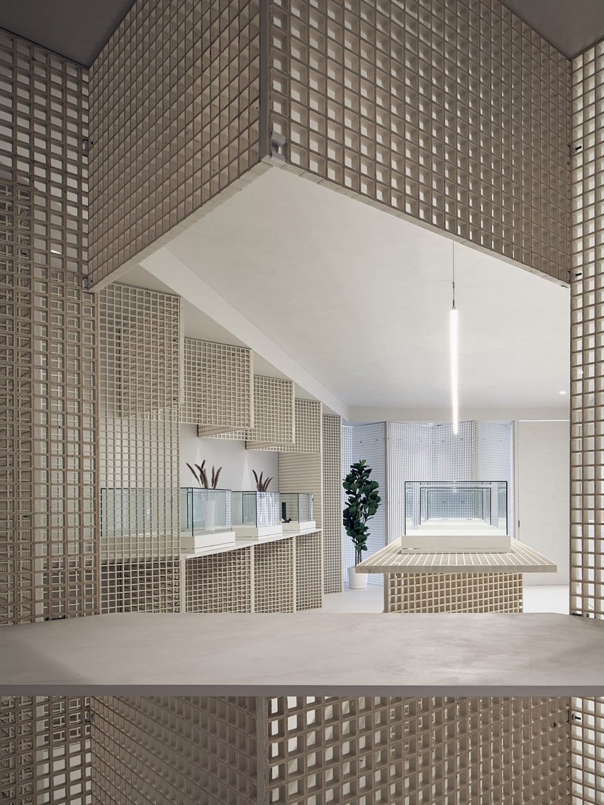 Walls and counter clad in industrial grating by StudioAC