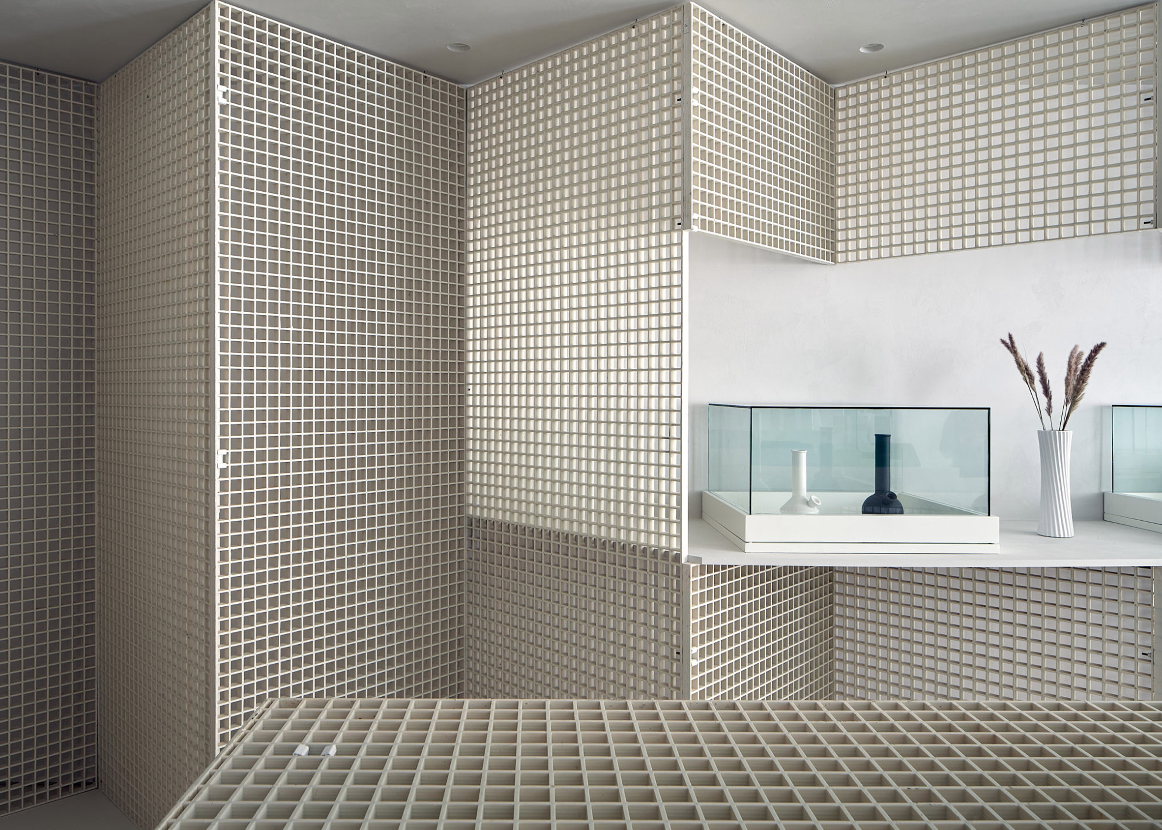 Metal gridded walls and display tables St. Clair West Edition store