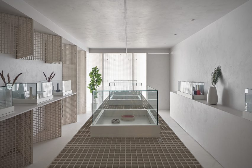 Cannabis dispensary with industrial grating walls and displays by StudioAC