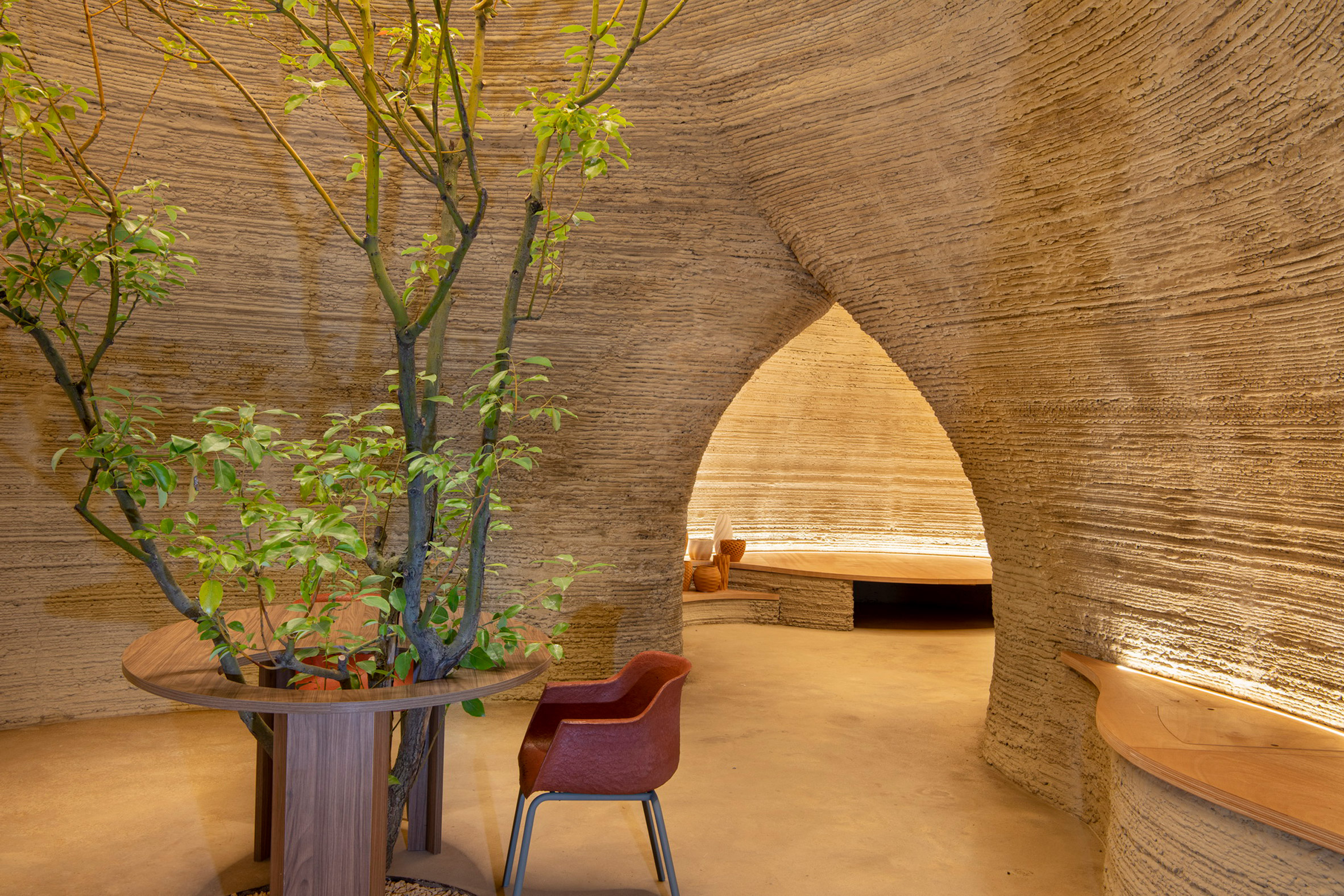 Arches lead between the two spaces by Mario Cucinella Architects and Wasp