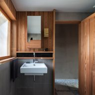 A bathroom lined with wood and tiles
