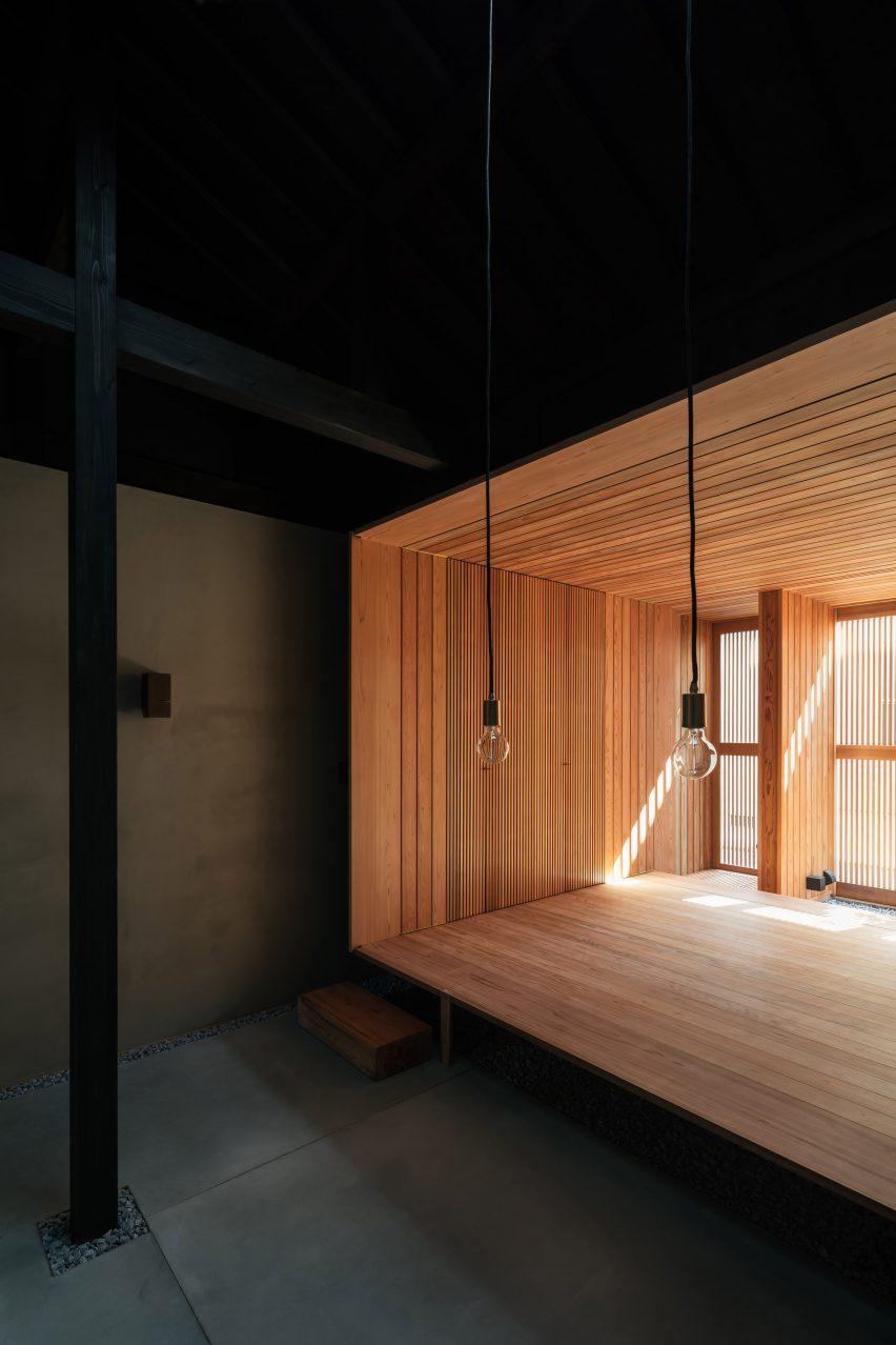 A cedar room inside a dark Japanese house