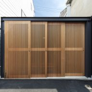 Shutters enclosing a small Japanese house