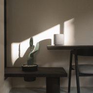 A minimalist workspace with black furniture