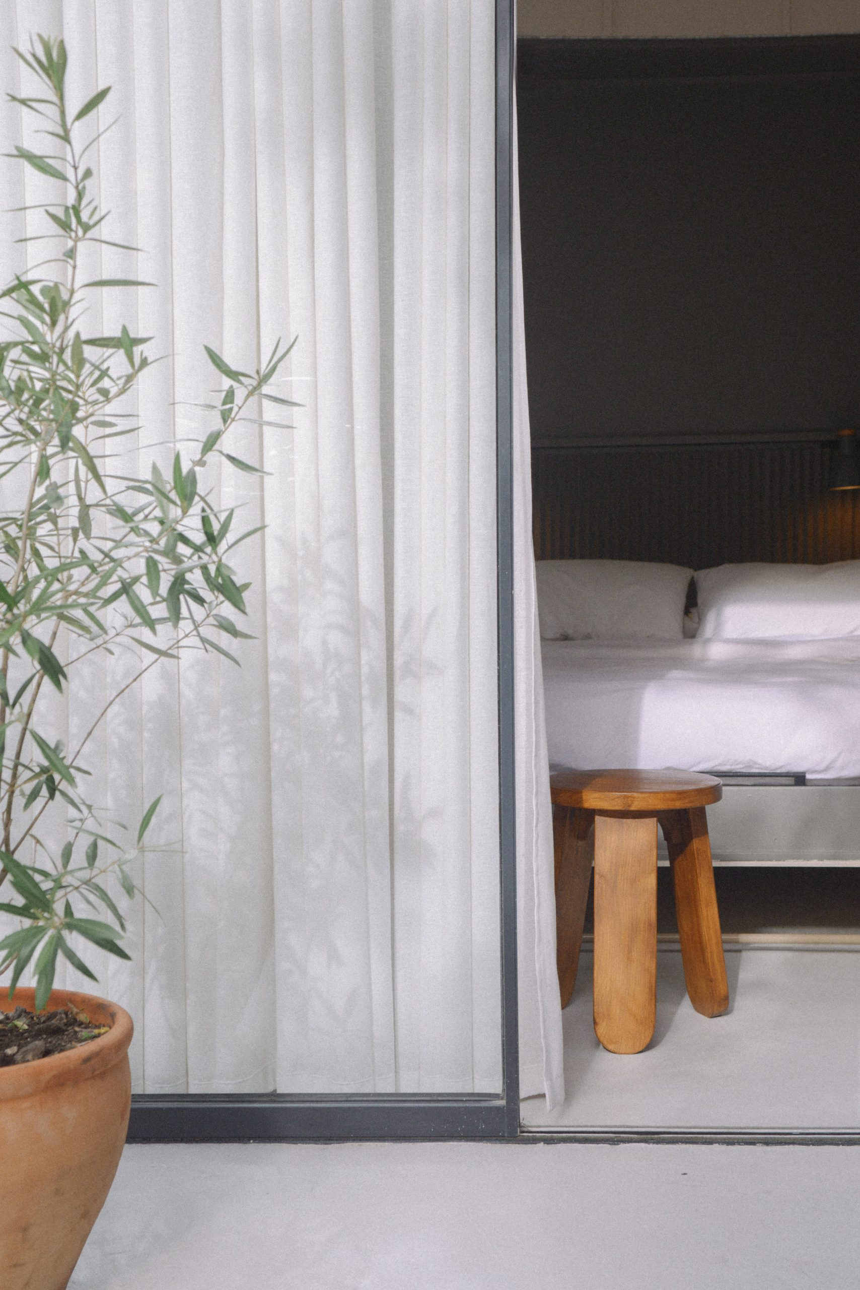 A bedroom with a glazed wall