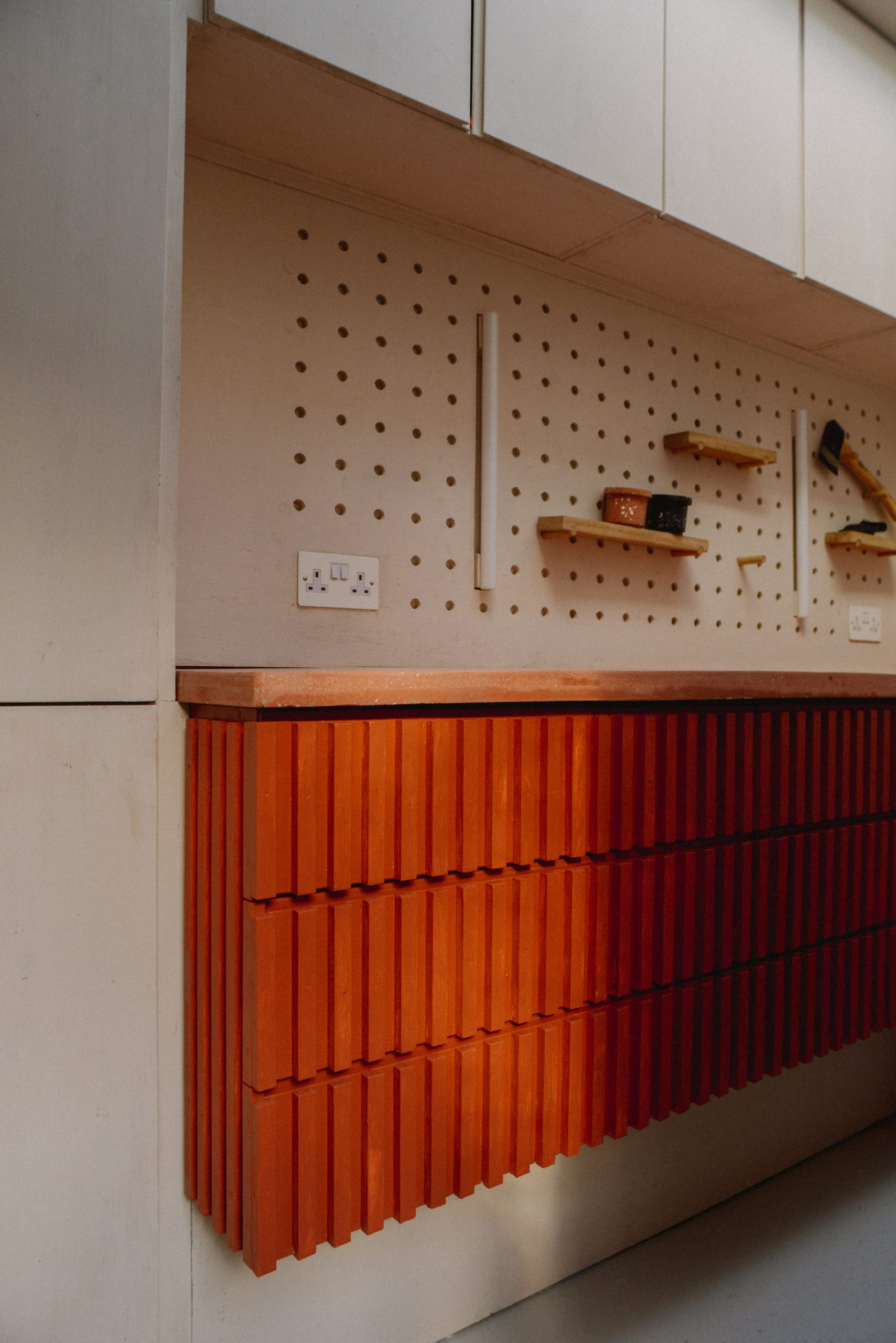A workshop with a pegboard