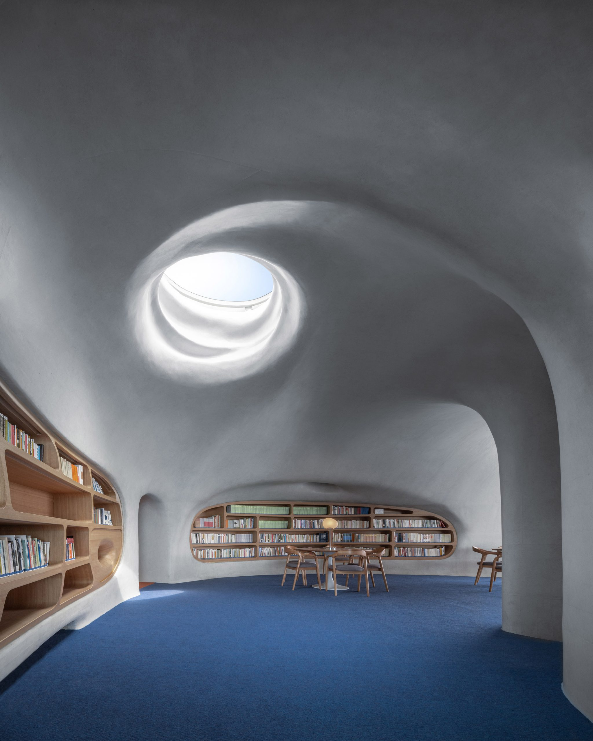 A library lit by a circular skylight