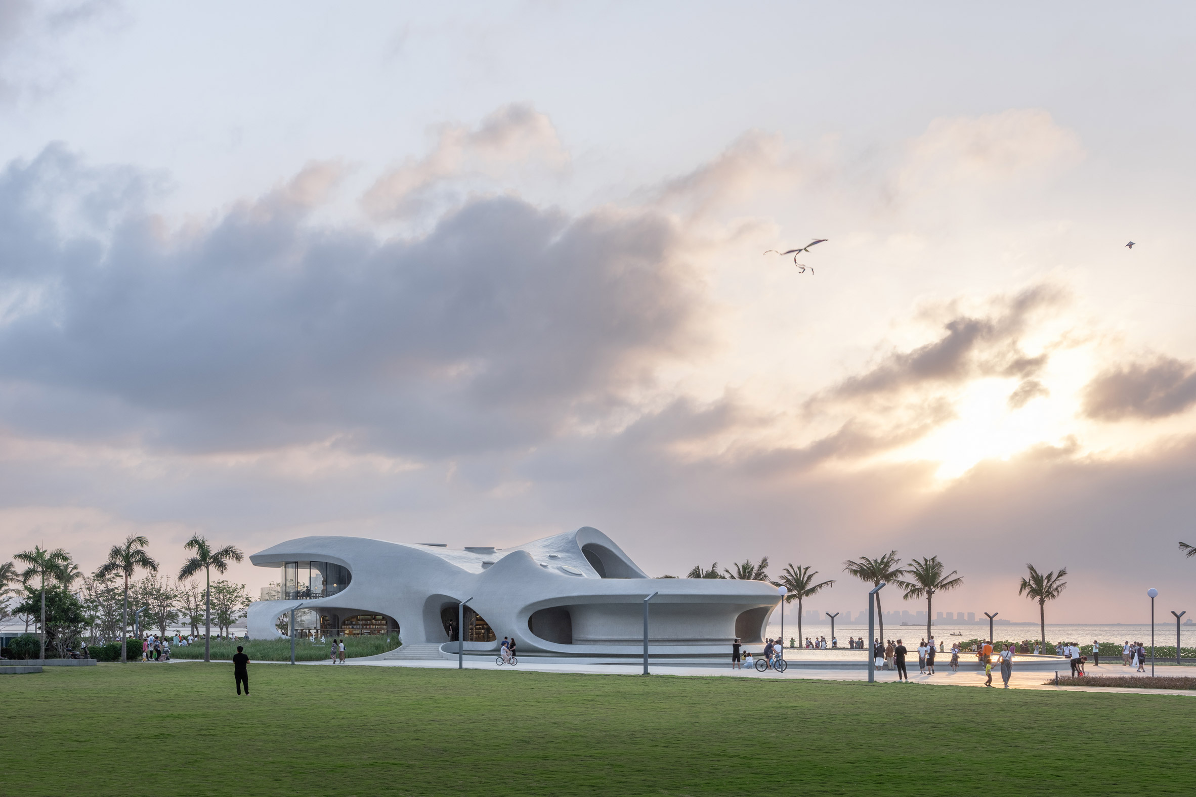A sinuous pavilion made from white concrete by MAD