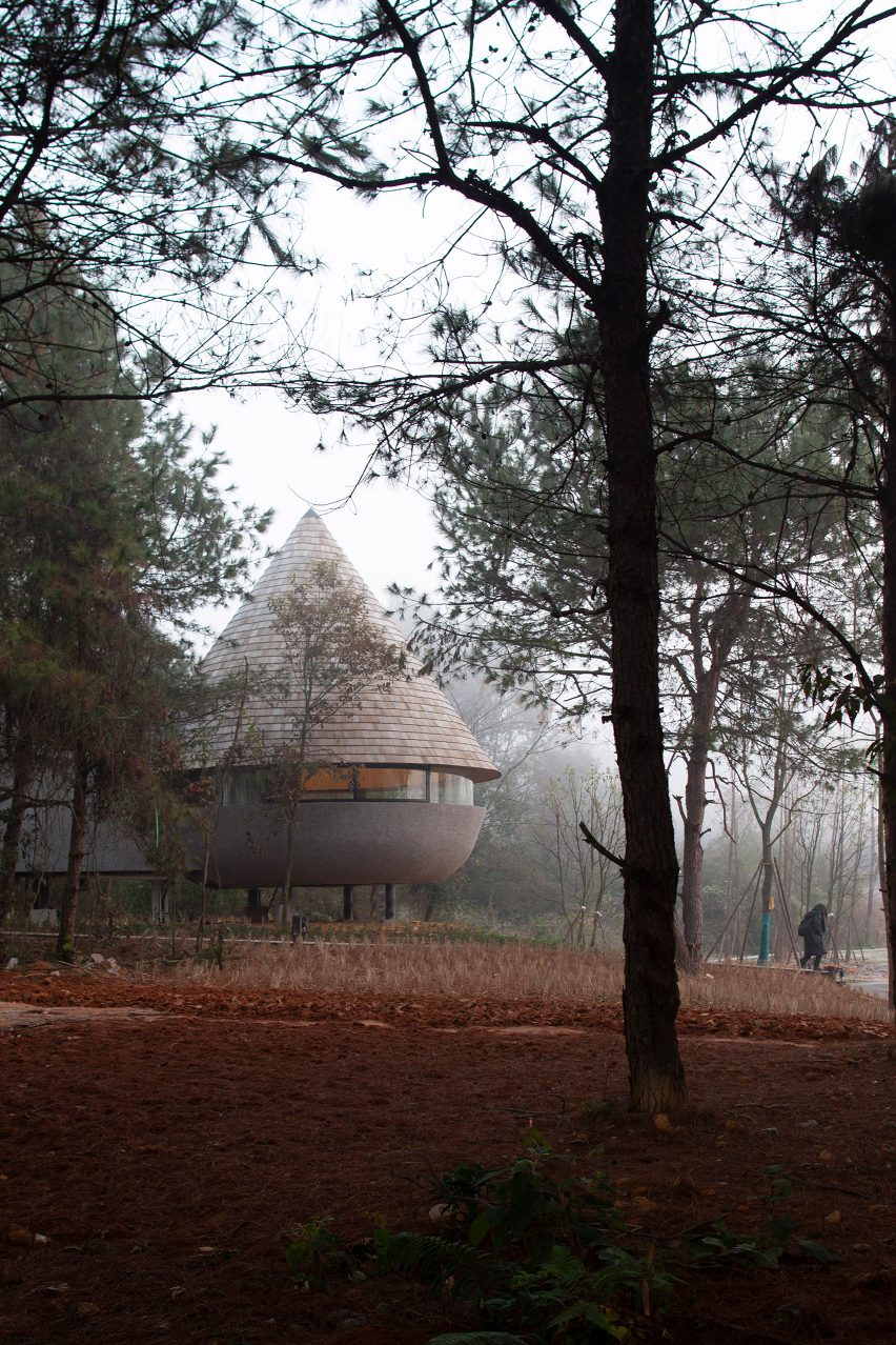 A rural guesthouse with a cone-shaped roof