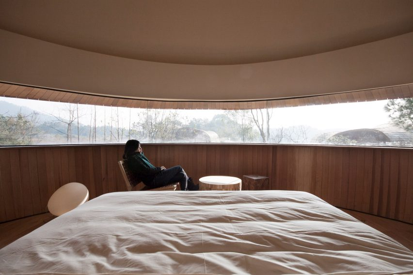 A bedroom with a panoramic window
