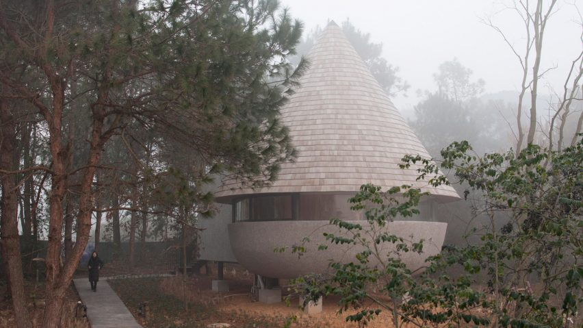 A guesthouse with a conical roof