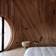 A wood-lined bedroom