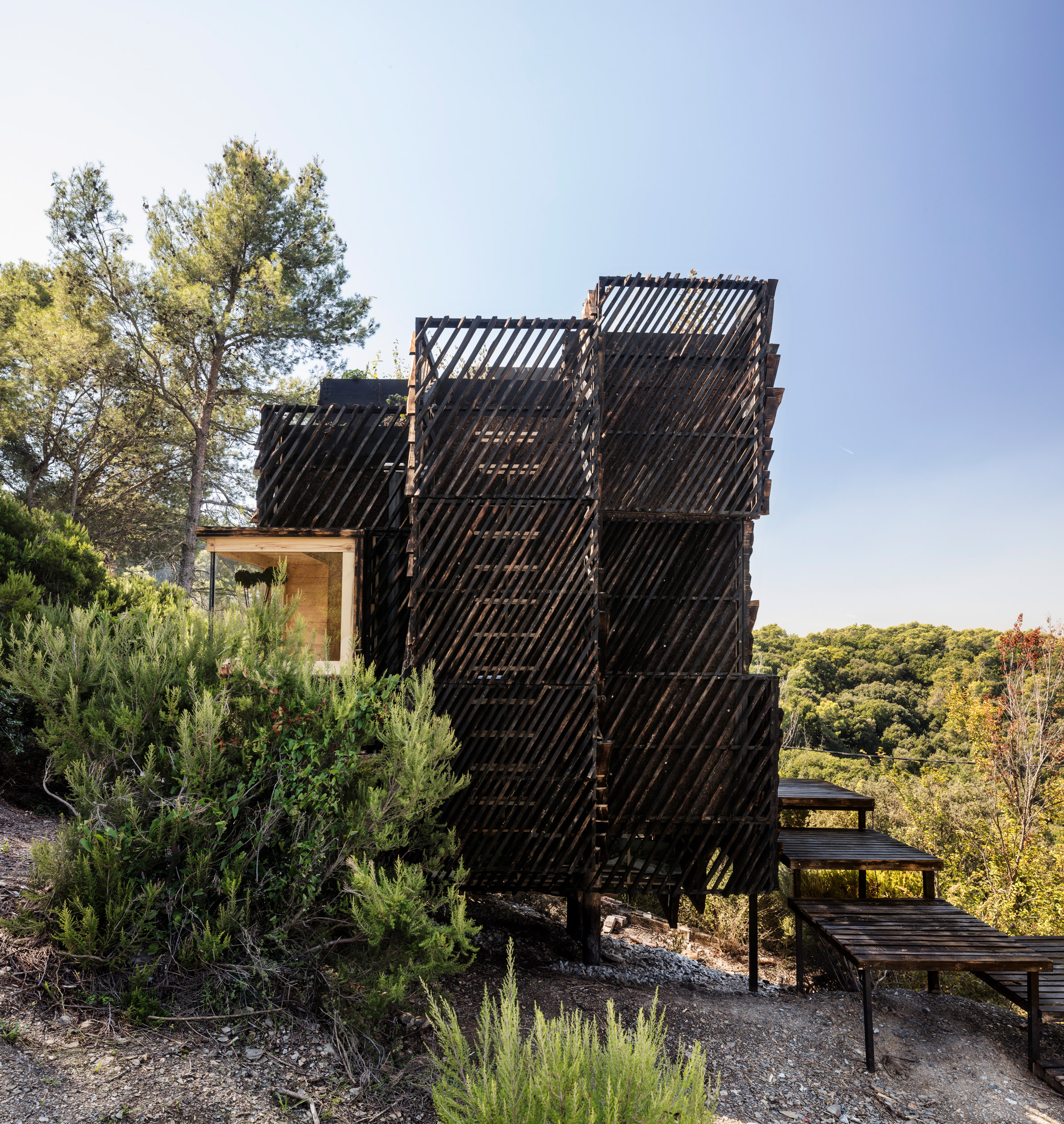 A cabin wrapped in slatted panels