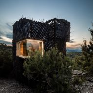 A cabin with a slatted exterior