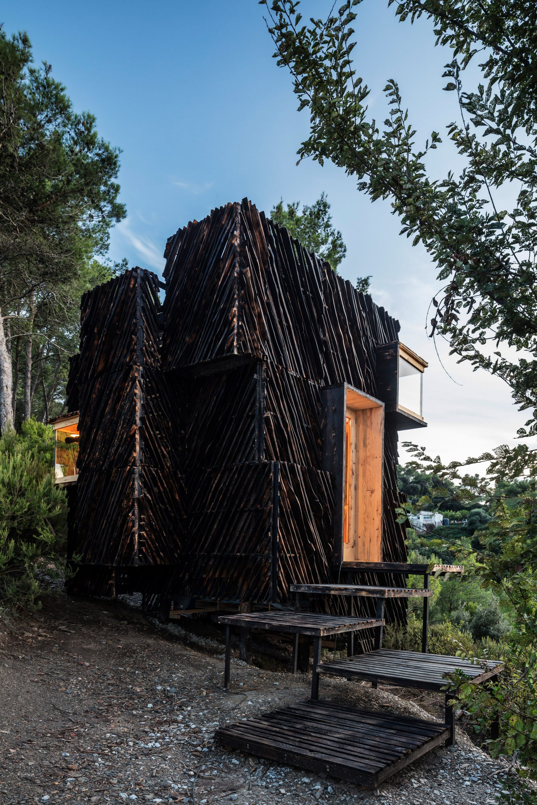 A cabin clad in charred timber