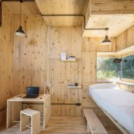 The interiors of a pine-lined cabin