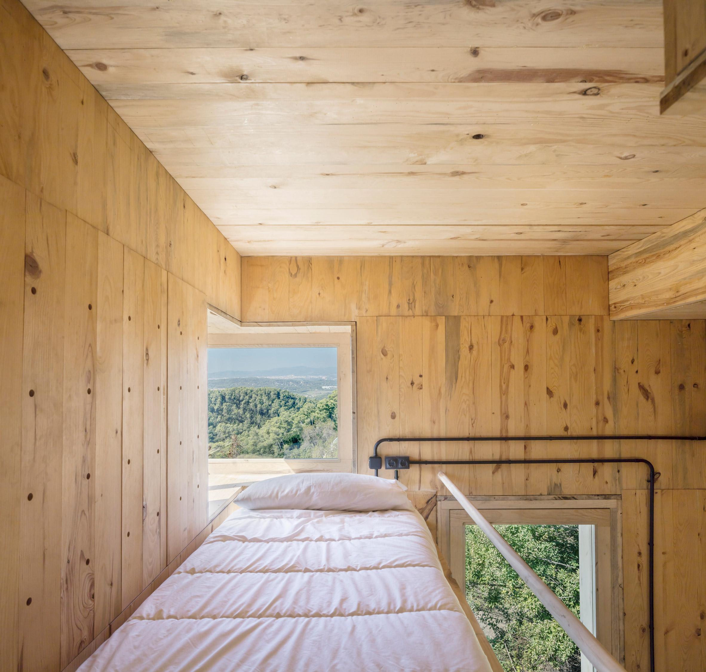 A platform bed inside a rural cabin