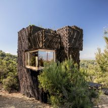 A cabin with charred wood cladding