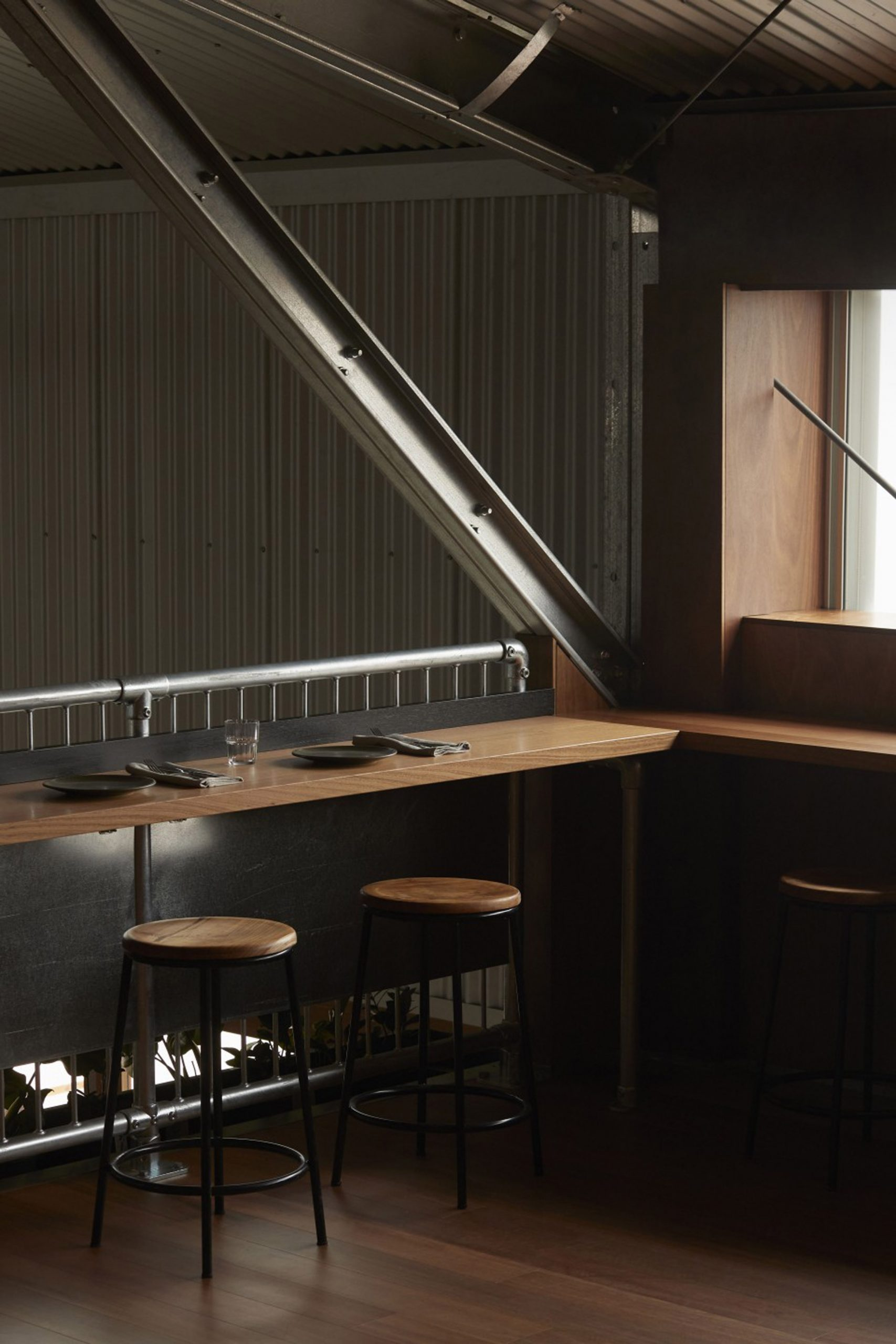 Mezzanine counter seating in restaurant interior by Pattern