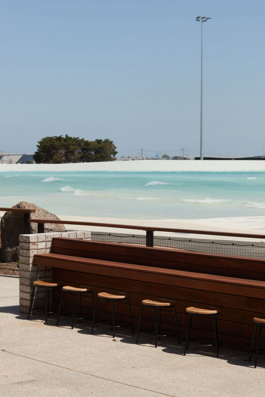 Wooden seating area overlooking wave pool in Melbourne Urbnsurf