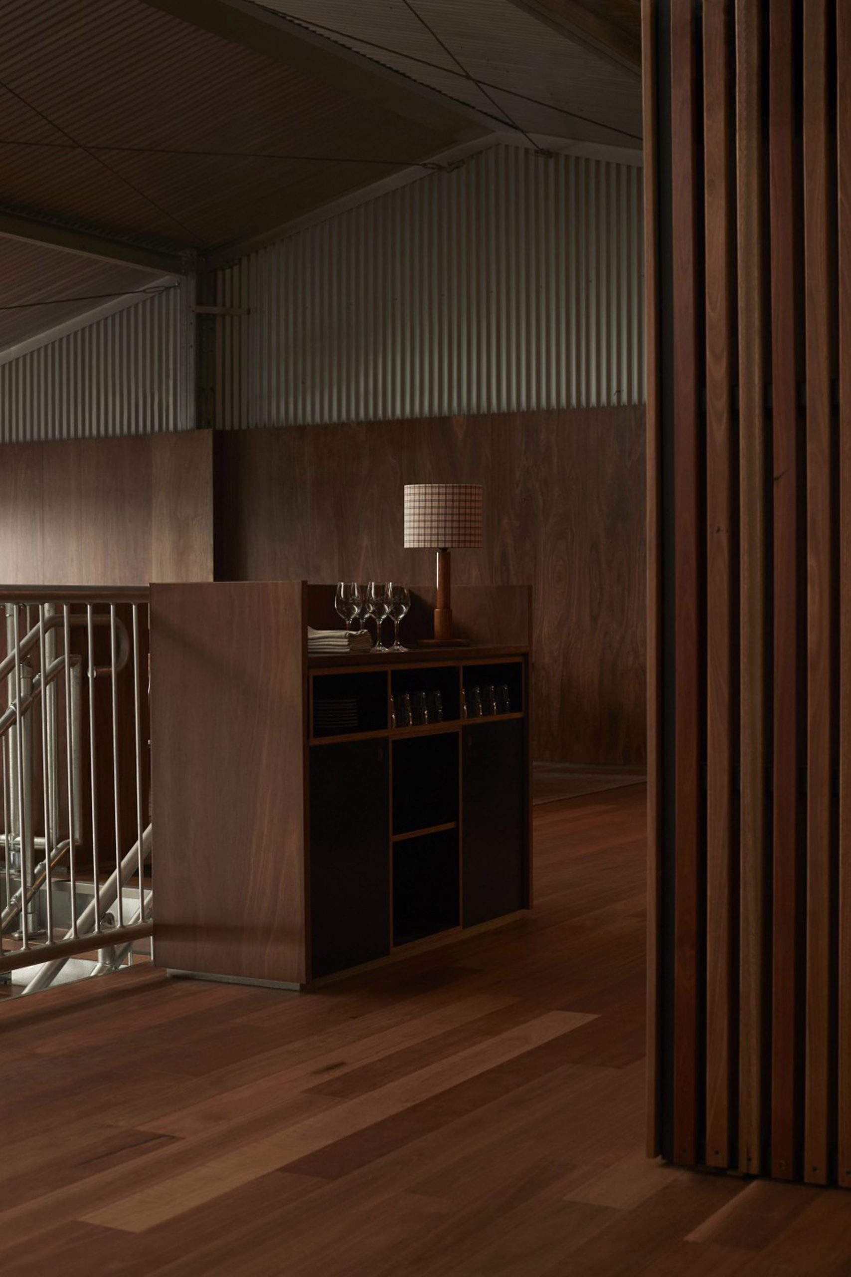 Wood-panelled floor and walls as well as service counter in Three Blue Ducks restaurant in Melbourne Urbnsurf