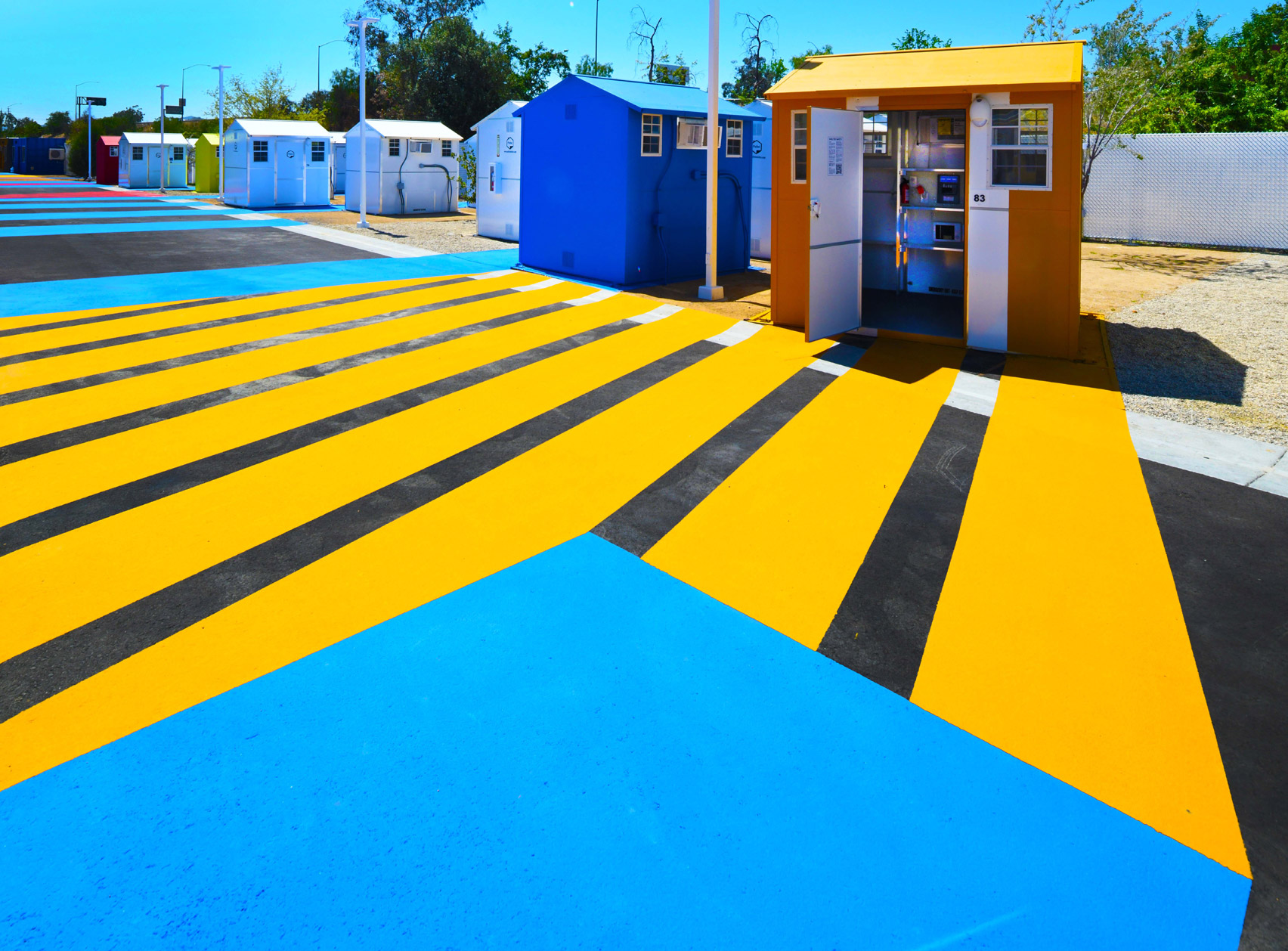 Colourful asphalt in a housing complex by Lehrer Architects