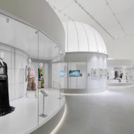 Curved display cabinets are organised around the exhibition