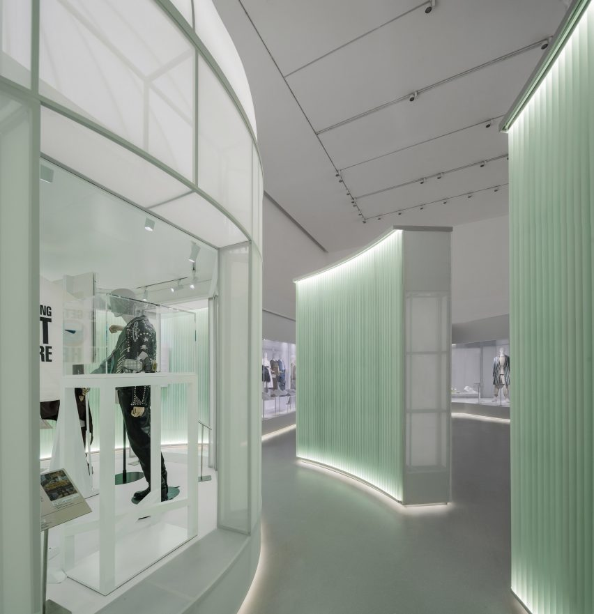 Acrylic pipes form a wall around the display cases by Studio 10