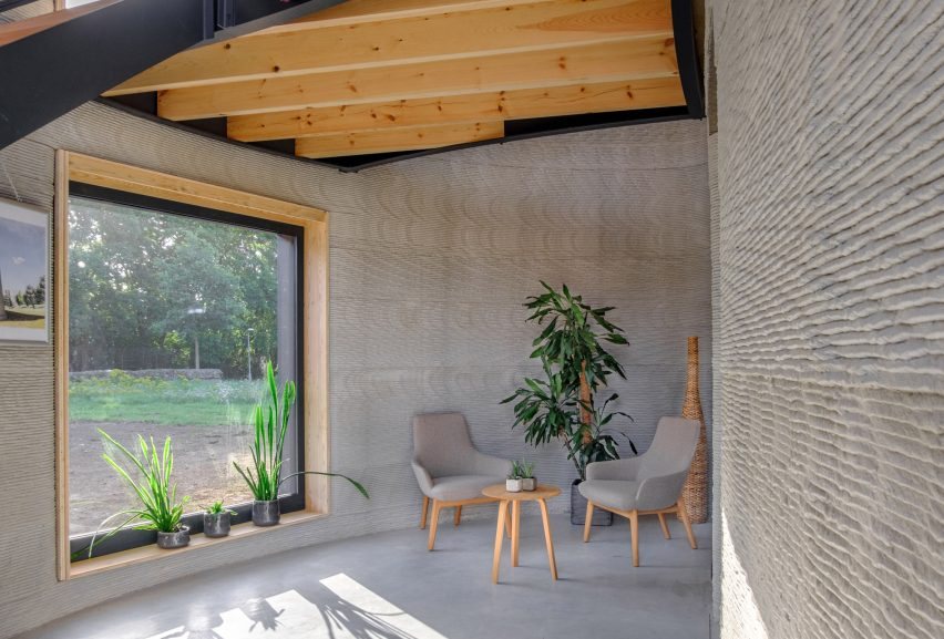 The walls of the 3D-printed home were left exposed