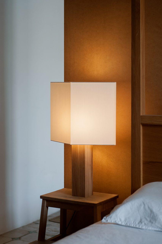 Oak and linen lamp by Gofi on a bedside table