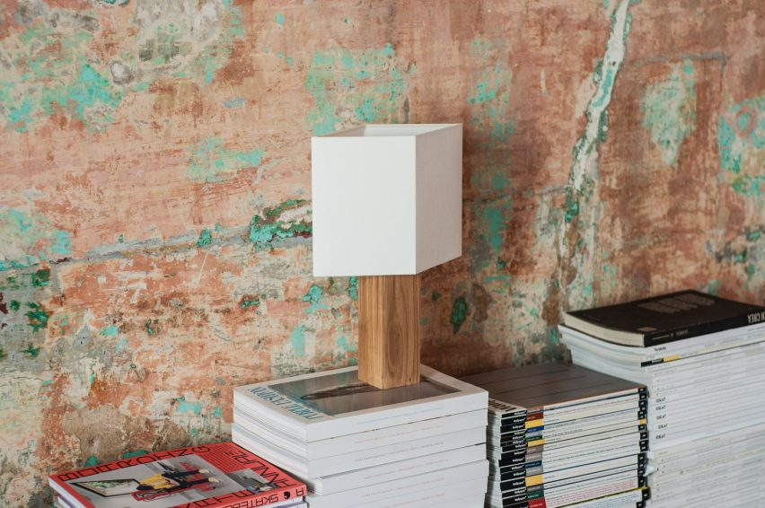 Chata lamp on a stack of magazines