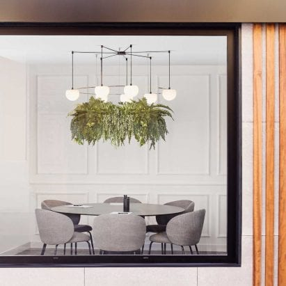 Circ pendant with planter hanging in an office meeting room