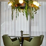 Circ pendant with planter hanging above a dining table