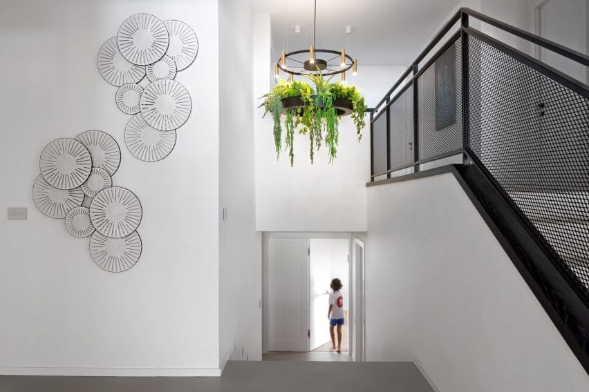 Foyer with contemporary chandelier