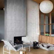 Living room with tiled wall