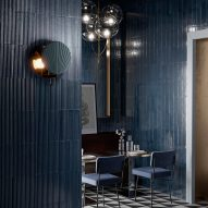 Moody restaurant interior with indigo blue wall tiles