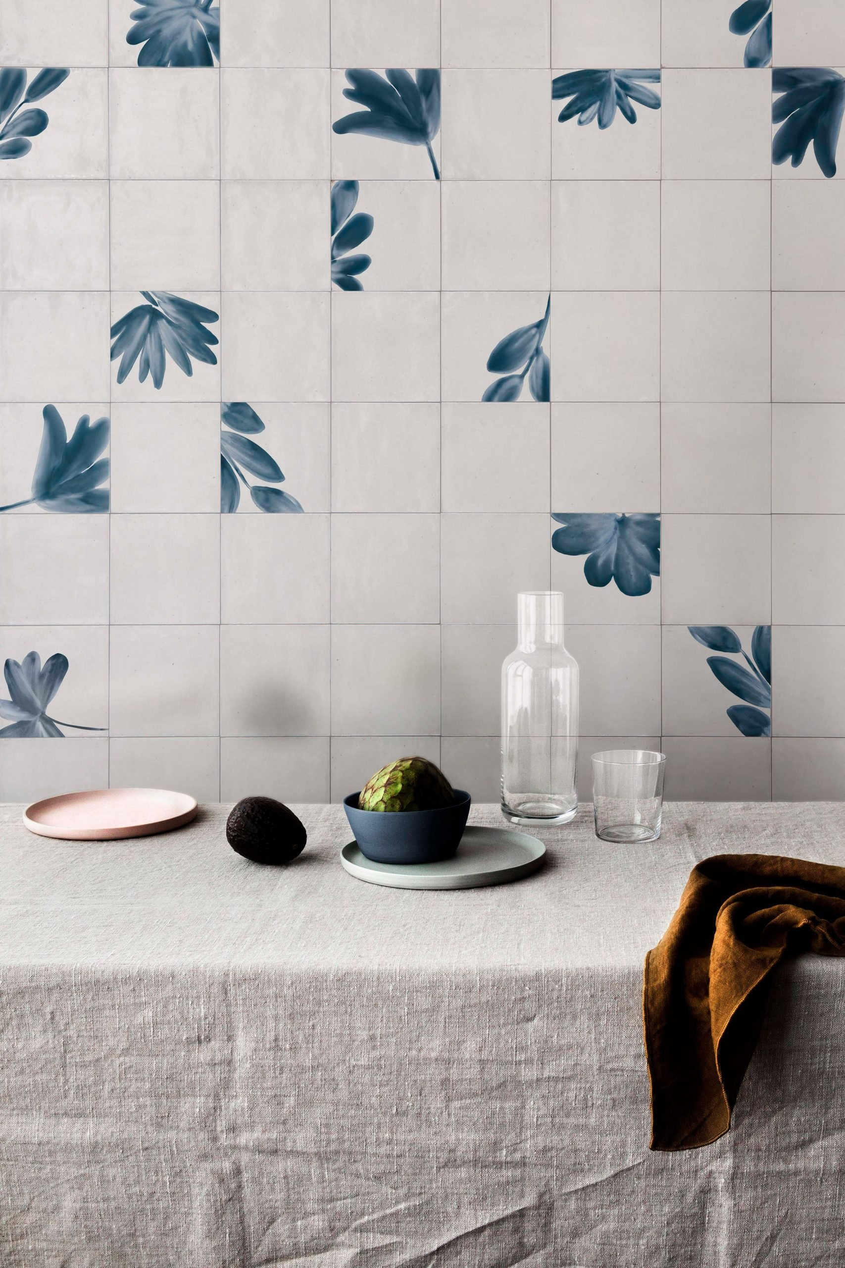 The Crogiolo Rice collection includes tiles with nature-inspired motifs in blue