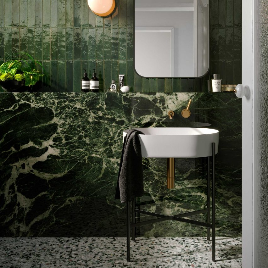 Green bathroom with complementary tile combination from Grand Marble Look collection