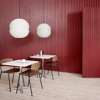 Lynderup chair with black legs at restaurant with red walls