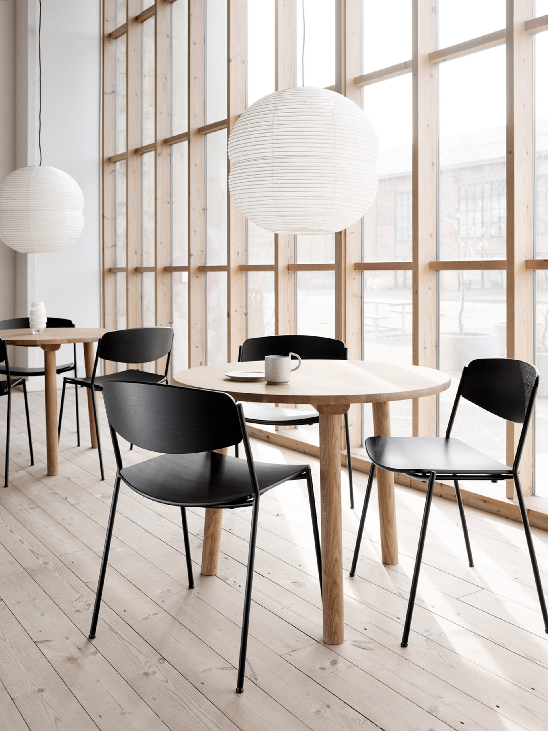 Black chairs at round cafe tables