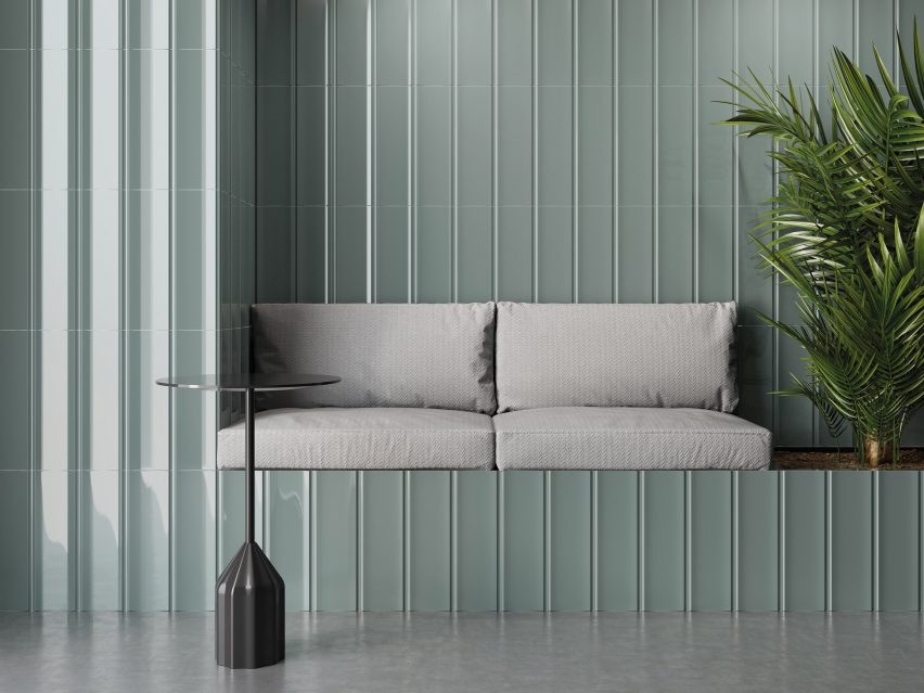 Concave grey-green wall tiles clad a seating nook